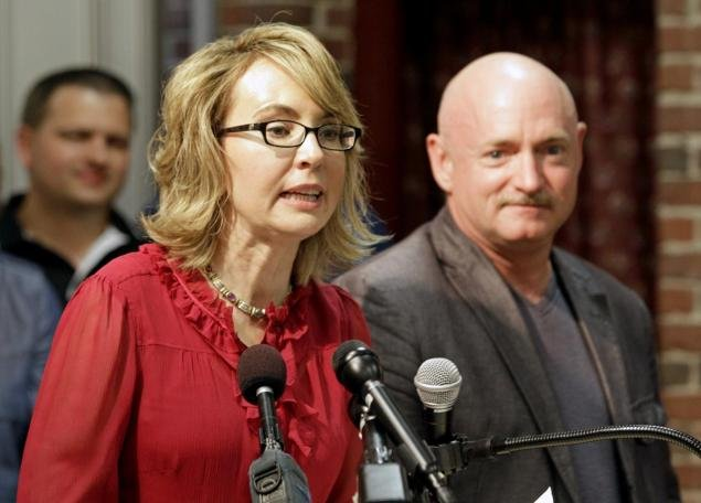 Gabby Giffords and Mark Kelly, AP file photo