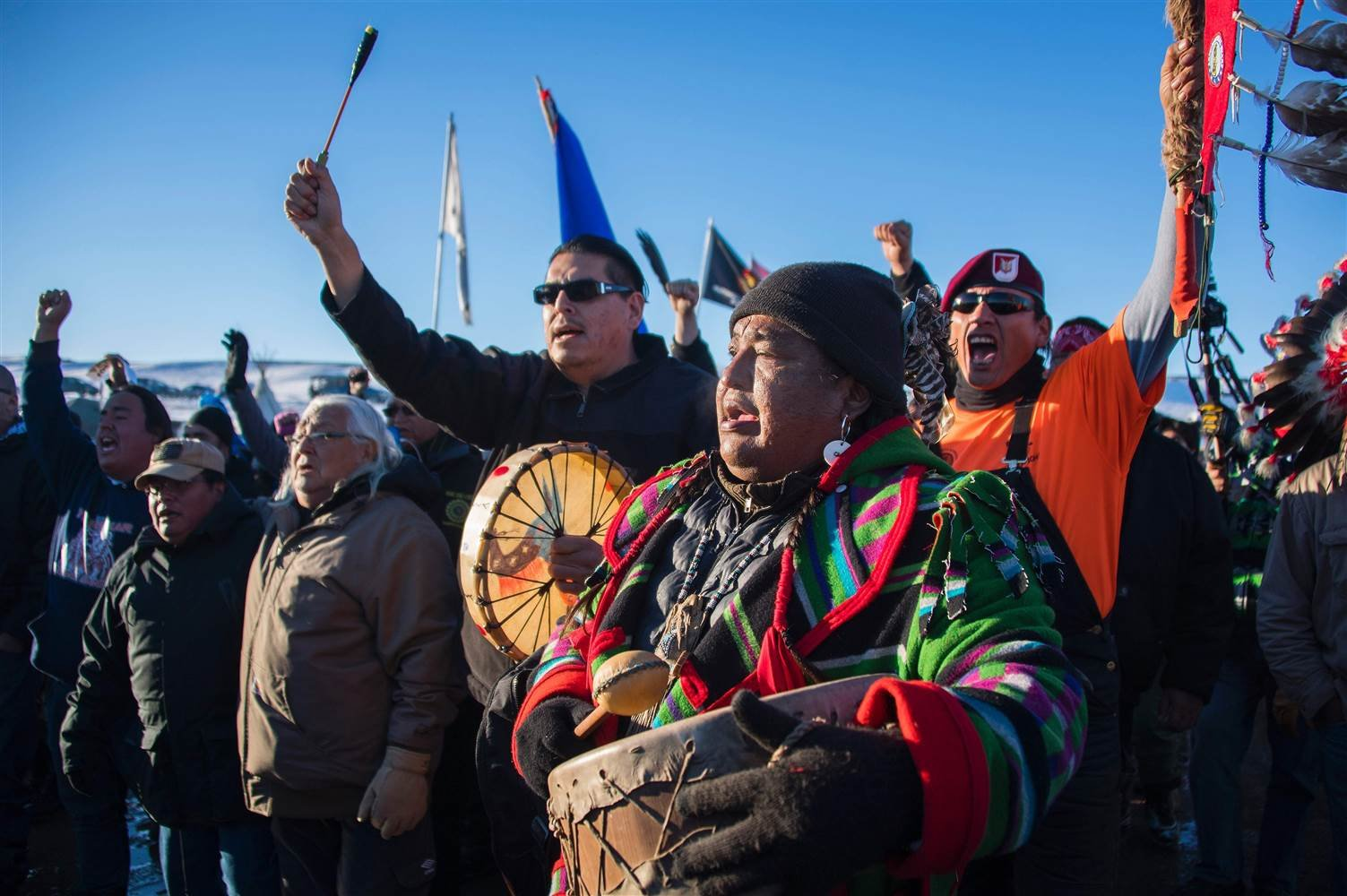 Activists celebrate at Oceti Sakowin Camp on the edge of the Standing Rock Sioux Reservation on Dec. 4, 2016 outside Cannon Ball, North Dakota, after the Army Corps of Engineers said the current route of the pipeline will be denied.