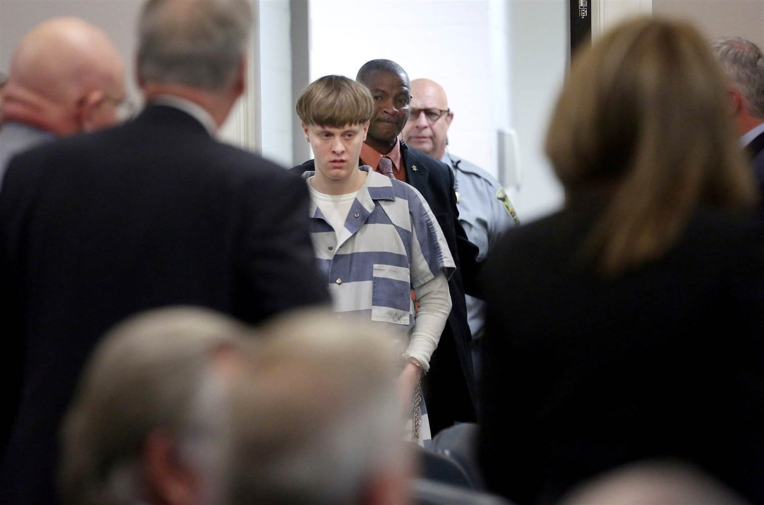 Dylann Roof is escorted into the court room at the Charleston County Judicial Center in Charleston, South Carolina, April 10, 2017. Grace Beahm/Pool / Reuters