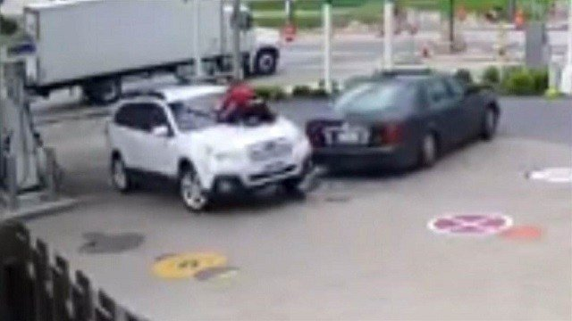 Woman jumps on hood to prevent carjacking
