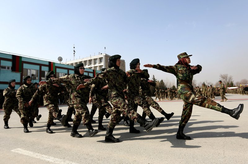 FILE - In this Sunday, Feb. 14, 2016 file photo, new members of the Afghanistan's National Army march during their graduation ceremony at the Afghan Military Academy in Kabul, Afghanistan.(AP Photo/Rahmat Gul)