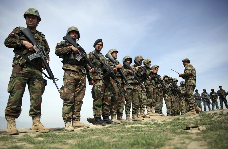 FILE - In this Tuesday, Mar. 15, 2016 file photo, Afghanistan's National Army soldiers stand guard, following weeks of heavy clashes to recapture the area from Taliban militants.(AP Photos/Massoud Hossaini)