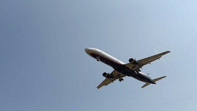 Grounded flights and power outages as temperatures soar in US