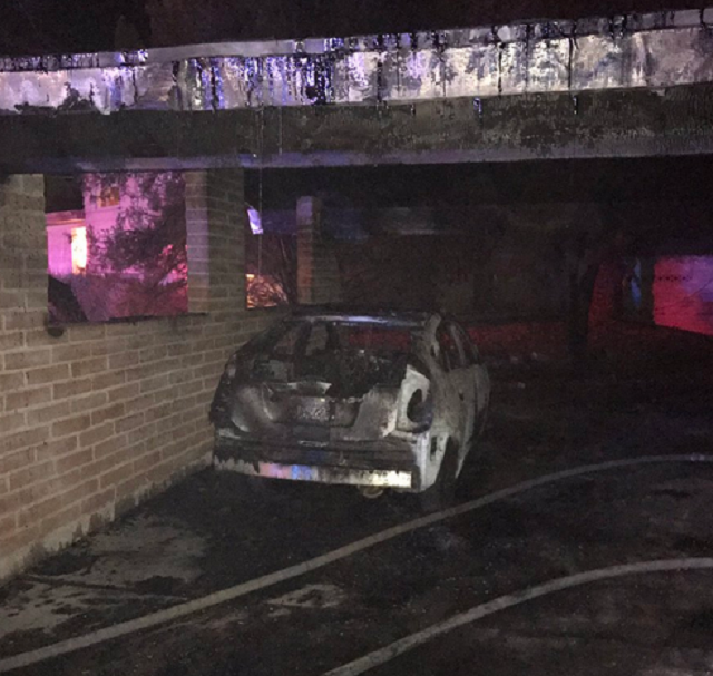 Carport fire destroys one of two vehicles. (Photo: Tucson Fire Dept.)