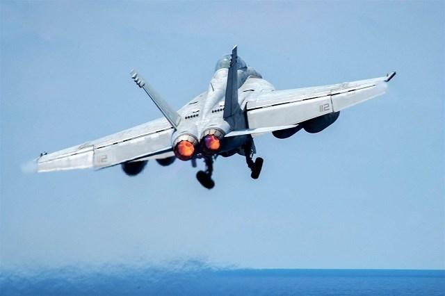 An F-18 Super Hornet aircraft Jake Cannady / Dept. of Defense via EPA