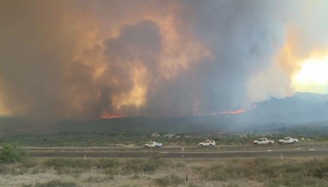 Smoke billows from the Goodwin Fire near Mayer