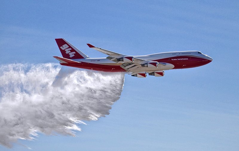 This May 5, 2016, photo provided by Global Supertanker Services shows a Boeing 747 making a demonstration water drop at Colorado Springs Airport in Colorado Springs, Colo. The company with the 747 retardant bomber that can drop nearly 20,000 gallons.