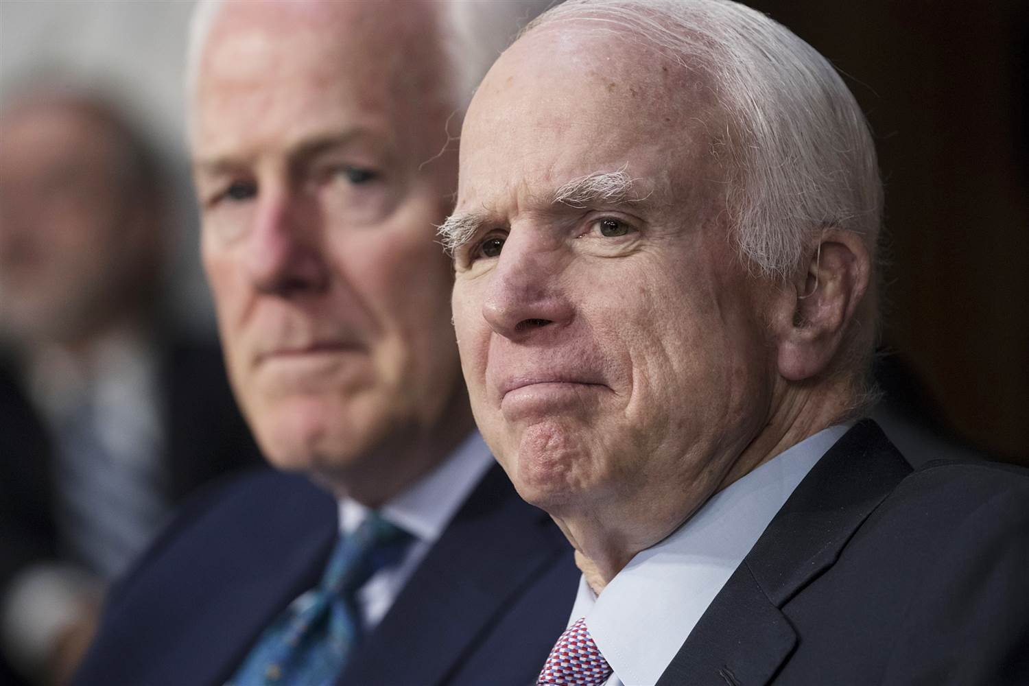Sen. John McCain, R-Ariz., right, with Sen. John Cornyn, R-Texas, listens as Attorney General Jeff Sessions testifies on Capitol Hill in Washington on June 13, 2017. (J. Scott Applewhite / AP file)