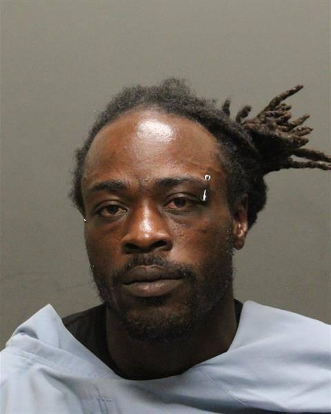 Mugshot of 33 year old Daniel Dionte Moore courtesy of Tucson Police Dept.