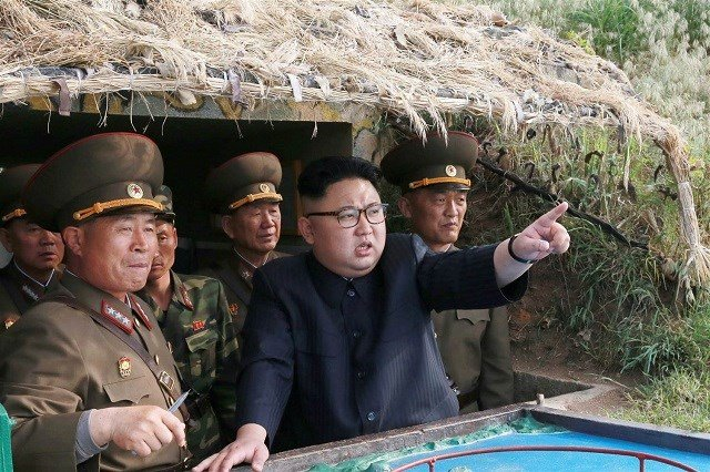 North Korean leader Kim Jong Un inspects the defence detachment on Jangjae Islet on Mu Islet in this undated photo released by North Korea's Korean Central News Agency. KCNA / via Reuters and NBC