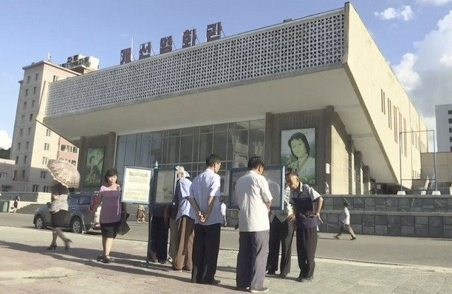 In this image made from video, people read newspapers displayed on the street in Pyongyang, North Korea, Friday, Aug. 11, 2017. Despite tensions and talk of war, life on the streets of the North Korean capital Pyongyang remained calm. AP Photo
