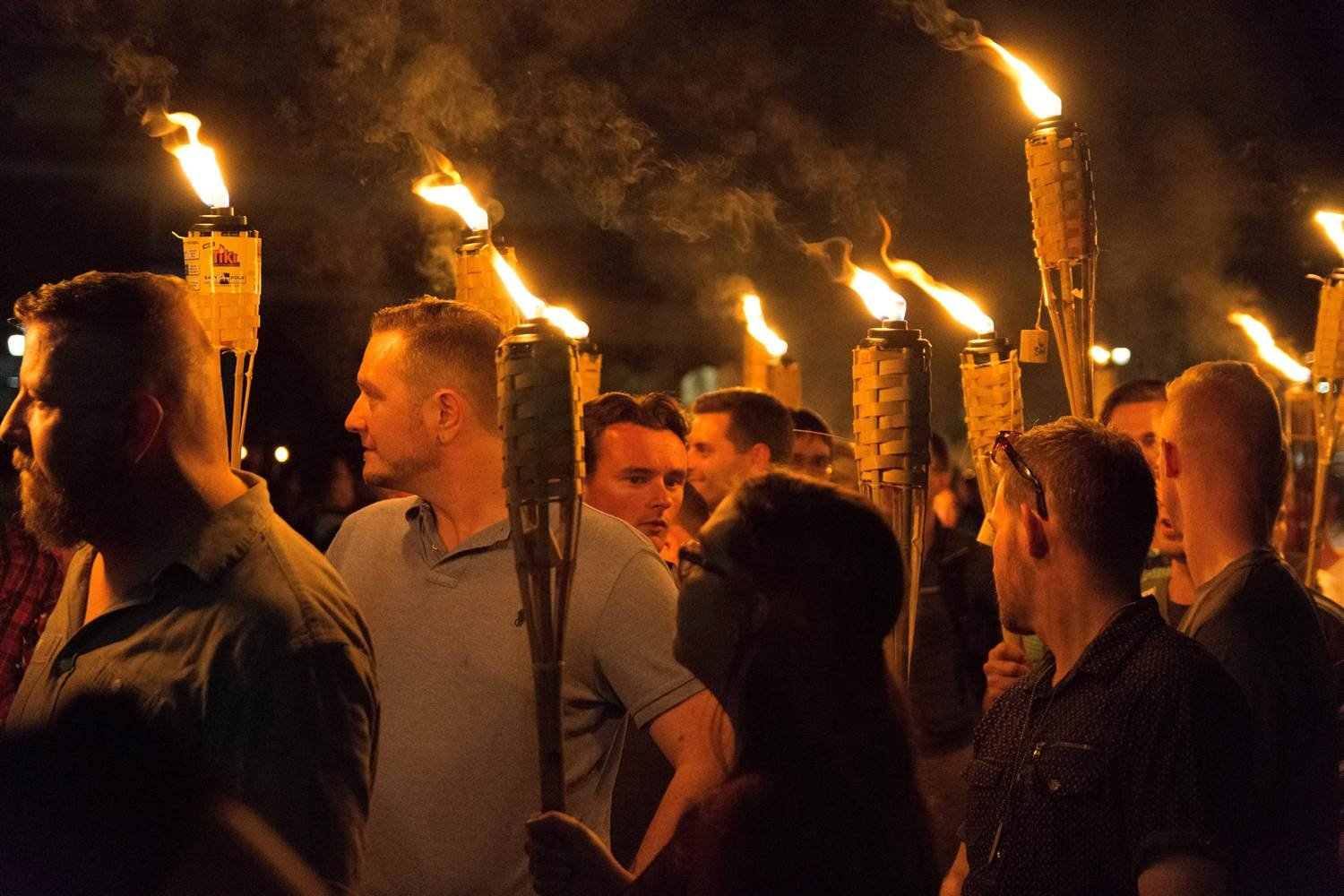 White nationalists carry torches on the grounds of the University of Virginia on the eve of a planned Unite The Right rally in Charlottesville on Friday. (STRINGER / Reuters)