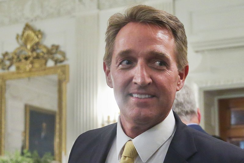 Flake Brushes off Trump's Criticism as President Lands in His Backyard