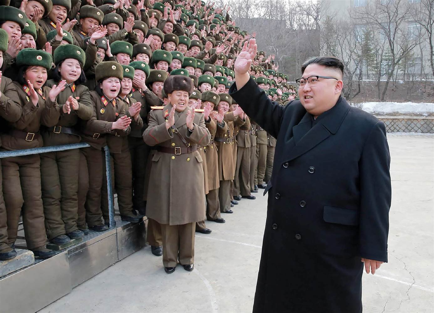 North Korean leader Kim Jong-Un (R) waving as he inspects the headquarters of Large Combined Unit 966 of the KPA at an undisclosed location on March 1, 2017. (KCNA via KNS / AFP/Getty Images)
