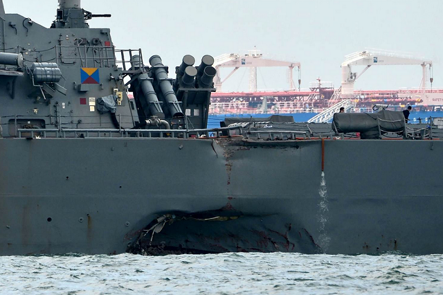 "The remains of ""some"" American sailors have been found in sealed compartments aboard the USS John S. McCain, Adm. Scott Swift of the U.S. Pacific Command said Tuesday.  (Roslan Rahman / AFP - Getty Images)"