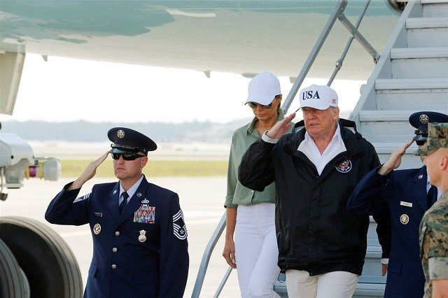 President Donald Trump returns a salute as he and first lady Melania Trump step off Air Force One prior to receiving a briefing on Hurricane Irma relief efforts in Fort Myers, Florida,on Sept. 14. Jonathan Ernst / Reuters via NBC