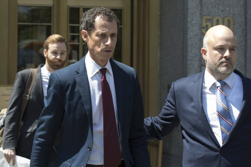 FILE - In this May 19, 2017, file photo, former U.S. Rep. Anthony Weiner, left, leaves Federal court in New York after pleading guilty to a charge of transmitting sexual material to a minor. (AP Photo/Mary Altaffer, File)