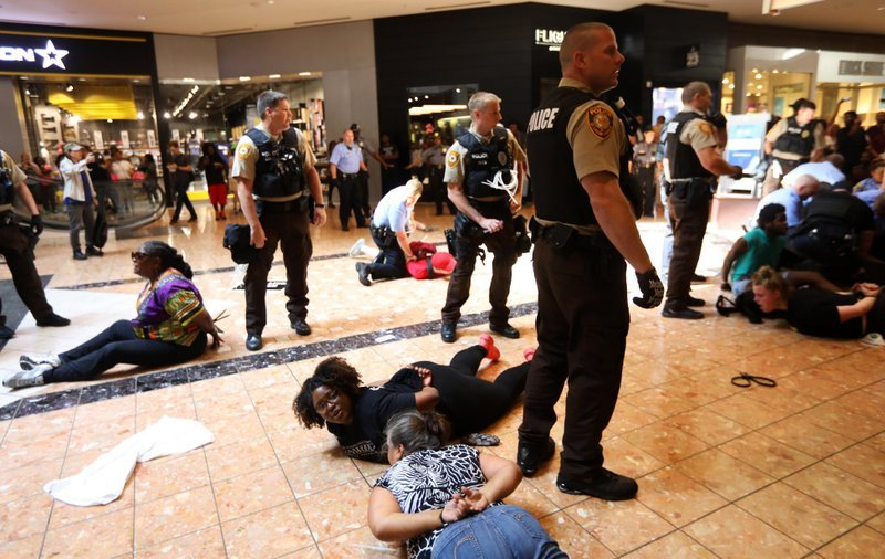 Protesters are arrested at the St. Louis Galleria mall in Richmond Heights, Mo., after several hundred people demonstrated in protest over the recent acquittal of a white former officer in the killing of a black suspect, in St. Louis.
