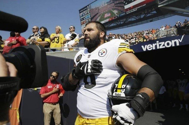 Pittsburgh Steelers offensive tackle and former Army Ranger Alejandro Villanueva stands outside the tunnel alone during the national anthem before an NFL football game against the Chicago Bears on Sunday in Chicago/ Nam Y. Huh The Associated Press