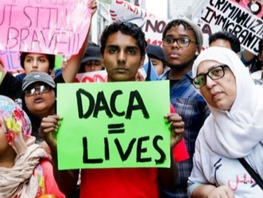 People gather for a rally and protest to mark the fifth anniversary of the Deferred Action for Childhood Arrivals (DACA) program near Trump Tower in New York, New York, on August 15, 2017. (Photo: Justin Lane, EPA)