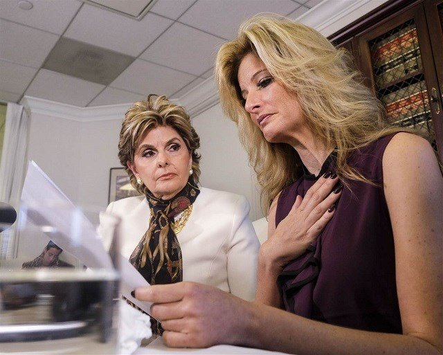 Attorney Gloria Allred, left, looks on as Summer Zervos reads a statement during a news conference in Los Angeles, Friday Oct. 14, 2016. Ringo H.W. Chiu / AP file