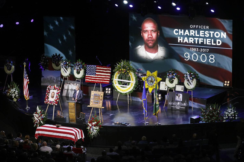 Pastor Mike Ellingsen speaks during a funeral for Las Vegas Police Officer Charleston Hartfield on Oct. 20, 2017 in Henderson, Nev.