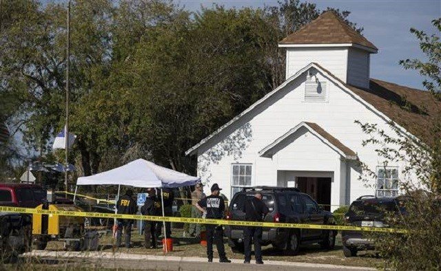 Law enforcement officials at the scene of a fatal shooting at First Baptist Church in Sutherland Springs, Texas, on Sunday. Nick Wagner / Austin American-Statesman via AP