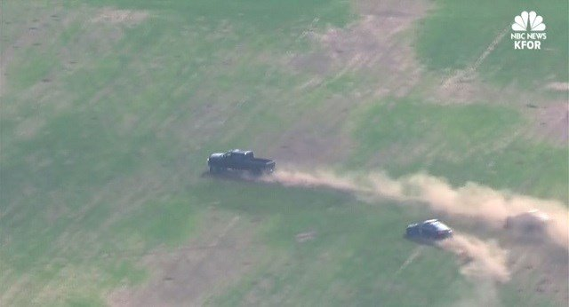 Oklahoma City Police chase stolen truck's driver down freeway, through fields