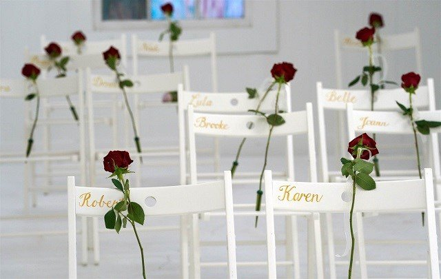 Roses are placed on chairs for the victims of last week's shooting at the First Baptist Church of Sutherland Springs as a memorial to those killed in Sutherland Springs, Texas on Nov. 12, 2017. Rick Wilking / Reuters