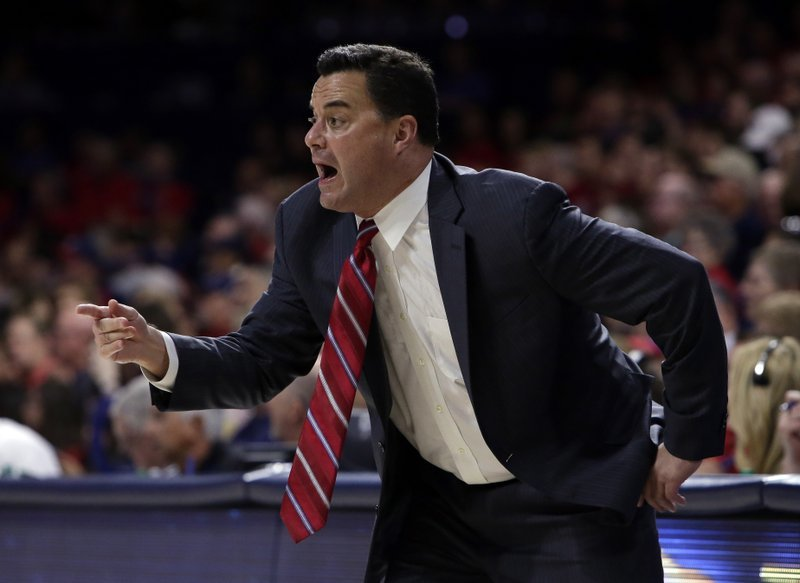 FILE - In this Nov. 10, 2017, file photo, Arizona head coach Sean Miller gestures in the first half during an NCAA college basketball game against Northern Arizona, in Tucson, Ariz.