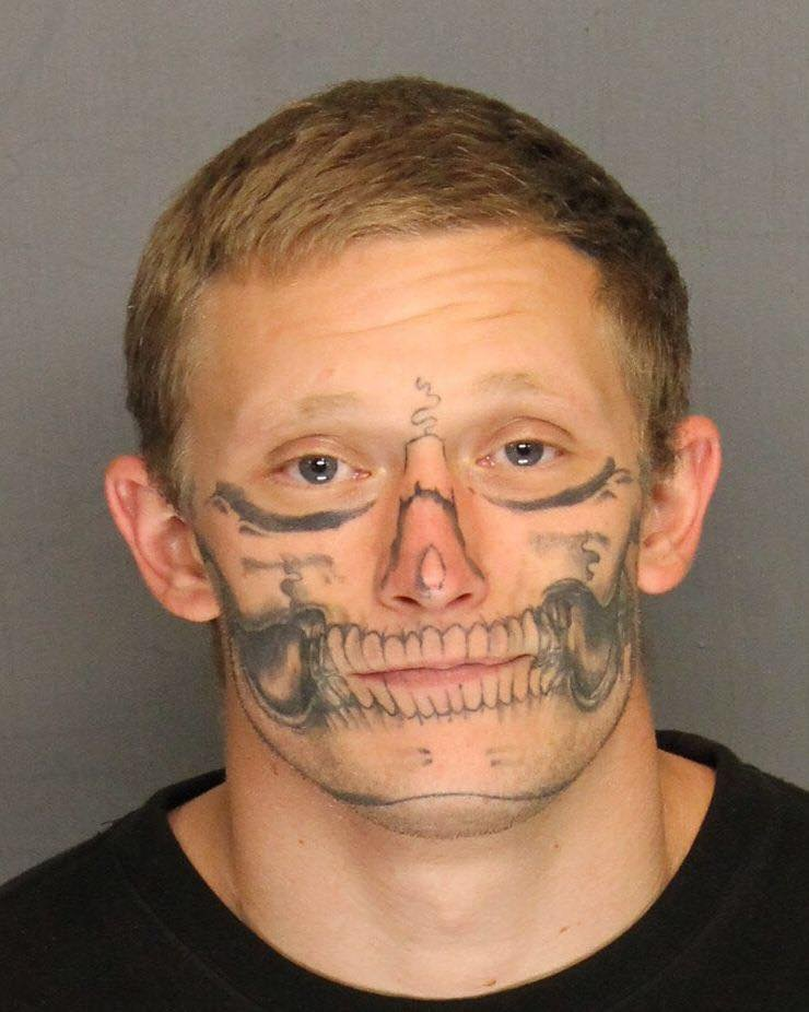 Authorities hunt for escaped inmate with facial skull tattoo