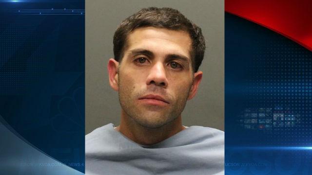 Jesus Harmon's booking photo courtesy of Tucson Police Dept.