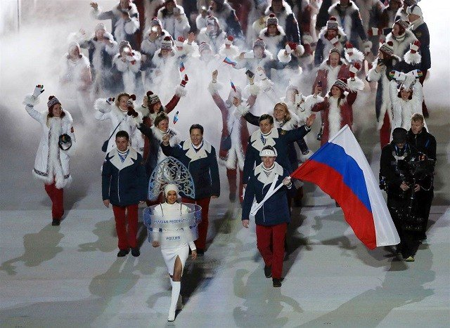 The Russian delegation walks into the Opening Ceremony of the Sochi Winter Olympics on Feb. 7, 2014 in Sochi. Adrian Dennis / AFP - Getty Images file via NBC