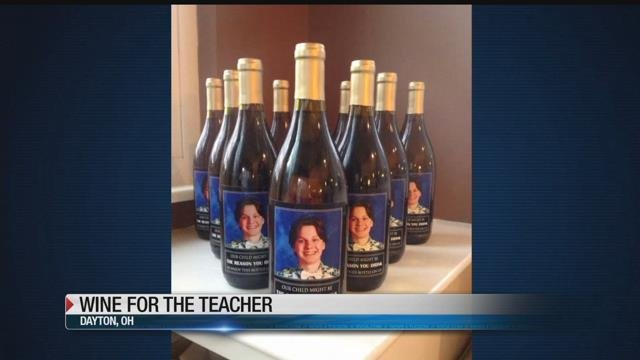 Parents give teachers wine bottles with picture of son's face for Christmas
