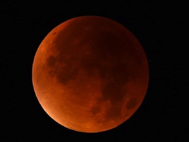 Skygazers in western Germany were treated to a rare astronomical event when a supermoon and lunar eclipse combined, showing Earth's satellite bathed in blood-red light on Sept. 28, 2015. Photo: Patrik Stollarz/AFP/Getty Images via KPNX
