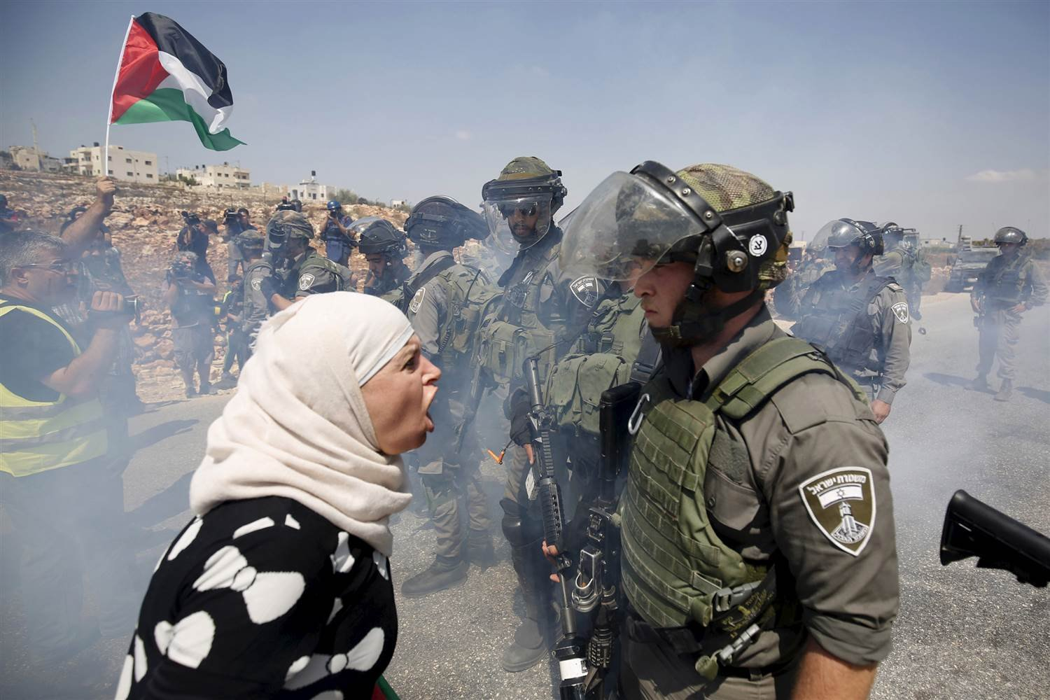 A Palestinian woman argues with an Israeli border police officer during a protest against Jewish settlements in the West Bank village of Nabi Saleh on Sept. 4, 2015. Mohamad Torokman / Reuters