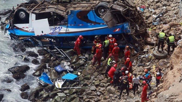 Rescue personnel work at the site of a bus accident north of Lima, capital of Peru, on Tuesday. Photo via CNN.