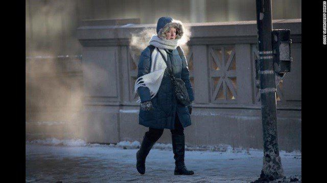 A woman in Chicago walks to work in sub-zero temperatures on Tuesday, January 2. Blasts of Arctic air have brought weather-related deaths, record-low temperatures and historic amounts of snowfall to parts of the United States. (Source: CNN).