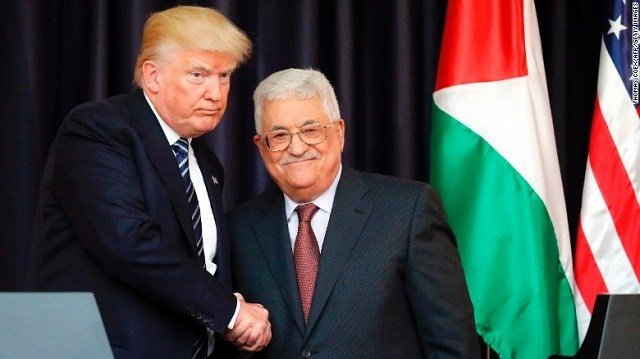 US President Donald Trump, left, and Palestinian leader Mahmoud Abbas shake hands at the presidential palace in Bethlehem on May 23, 2017. (Source: CNN)