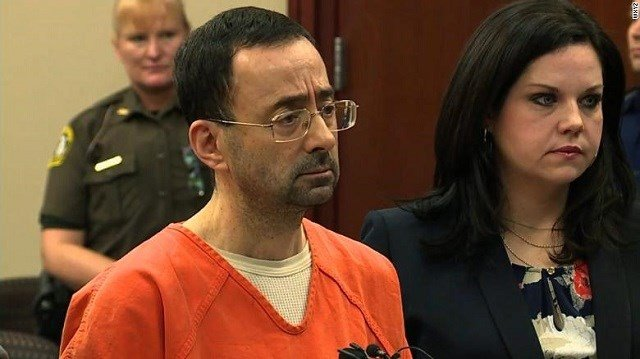 Simone Biles says former USA Gymnastics doctor Larry Nassar sexually abused her