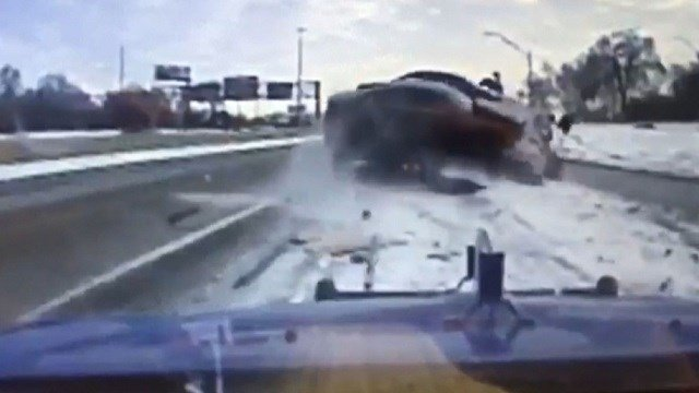 Auto narrowly misses hitting MI tow truck driver on icy freeway