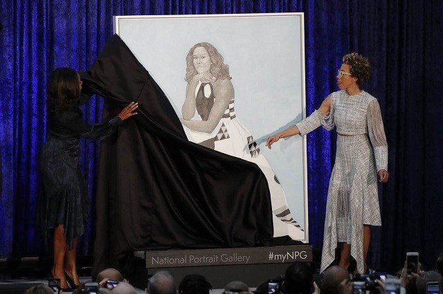 Artist Amy Sherald and former first lady Michelle Obama unveil the former first lady's portrait on Feb. 12, 2018. Jim Bourg / Reuters via NBC