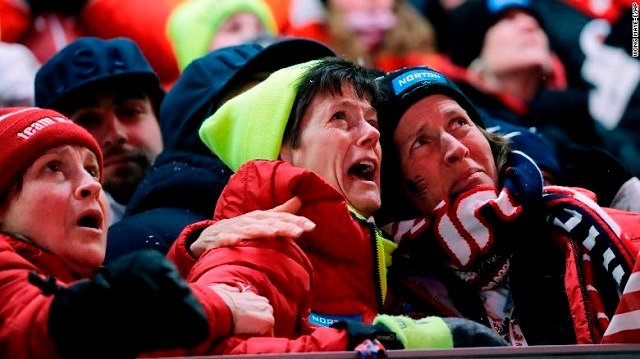 Sue Sweeney, center, the mother of Emily Sweeney of the United States, cries out as her daughter crashes on the final run during the women's luge final. Source: CNN