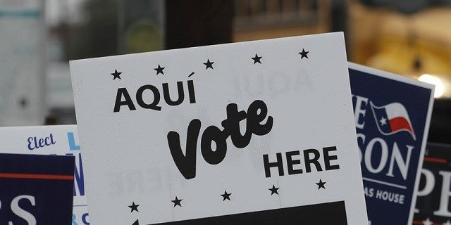 Signs mark a polling site in San Antonio for early voting that began Tuesday, Feb. 20, 2018 and ended Friday. The Texas primary is Tuesday, March 6. (AP Photo/Eric Gay) (Photo via NBC News)