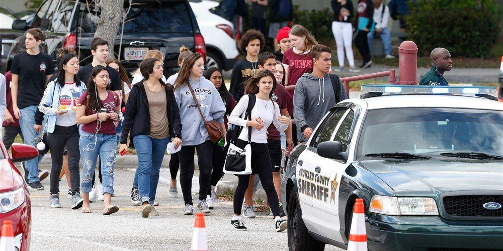 Marjory Stoneman Douglas High School students, staff and teachers exit the building following their return to school in Parkland, Florida, on Feb. 28, 2018.Rhona Wise / AFP - Getty Images file