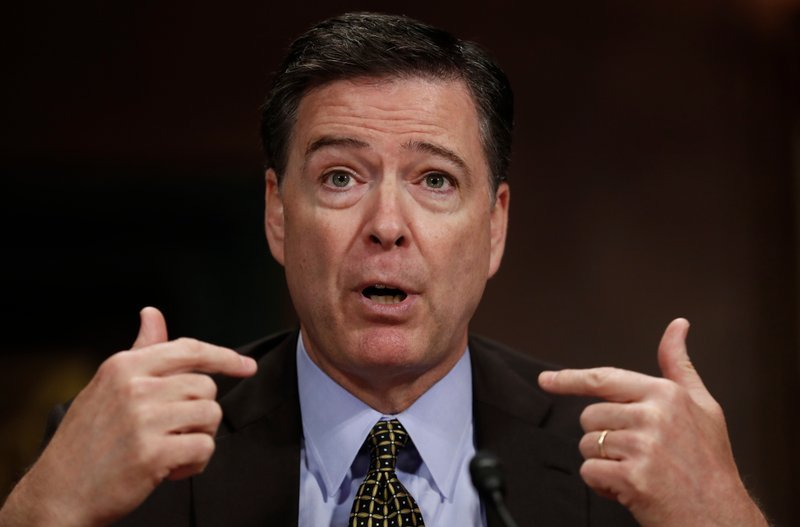 FILE - In this May 3, 2017, file photo, then-FBI Director James Comey testifies on Capitol Hill in Washington.