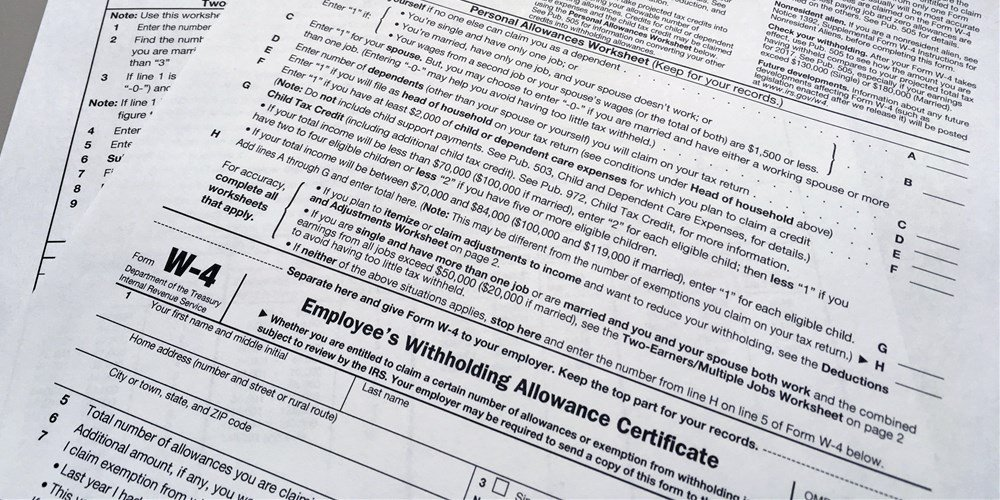 An IRS W-4 form on Feb. 1, 2018. Workers are starting to see more take-home pay as employers implement the new withholding guidelines from the IRS. - Barbara Woike / AP