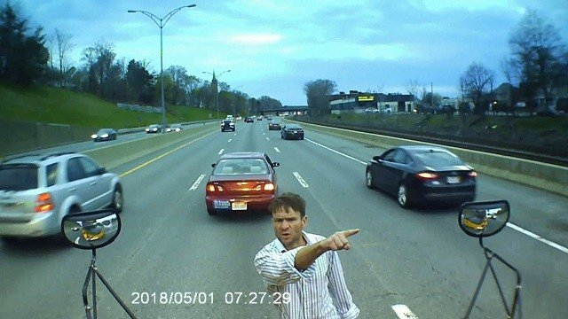 Driver stops in middle of highway, climbs on school bus