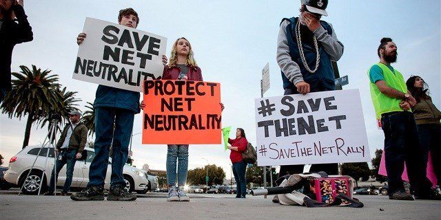 Supporters of net neutrality protest the FCC's recent decision to repeal the program in Los Angeles on Nov. 28, 2017.Kyle Grillot / Reuters file (Photo via: NBC)