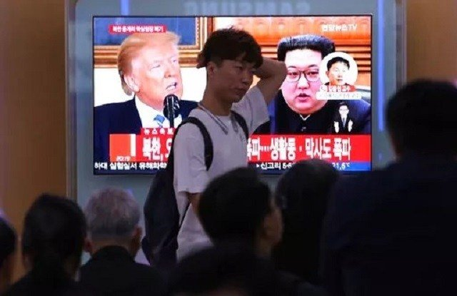 (AP Photo/Ahn Young-joon). People watch a TV screen showing file footage of U.S. President Donald Trump, left, and North Korean leader Kim Jong Un during a news program at the Seoul Railway Station in Seoul, South Korea, Thursday.